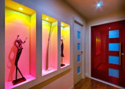 Colourful feature downlight installation in wall