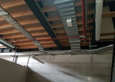 Hanging fluorescent lights in open ceiling